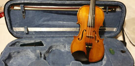 A lovely student violin with stand and a selection of books