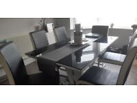 Black gloss dining table and 6 chairs