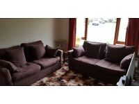 2 x 3 seater brown fabric sofas