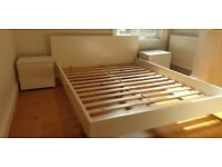 White King-sized Bed with Matching Side Tables