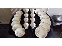 FOLEY FINE BONE CHINA TEA SET (HOLLYHOCKS PATTERN) - 20 PIECES - 1 BROKEN CUP HANDLE