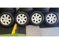 Fiat Genuine 14 alloy wheels + 4 x tyres 185 60 14 All Seasons