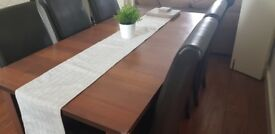 8 LEATHER DINING CHAIRS AND DARK WOOD DINING TABLE (EXTENDS)