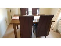 Hardwood dining table with 6 leather chairs
