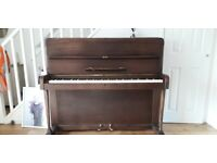 Small upright, neat piano