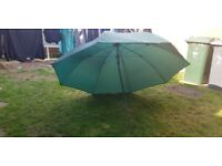 Fishing brolly with chair arm