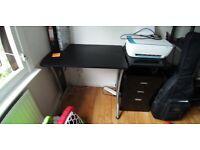Black medium desk for home office or study.