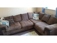 4 seater corner sofa with puffy, brown with scatter cushions