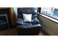 Chocolate-brown leather armchair (Arthur Llewellyn Jenkins)