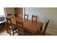 Solid oak dining table and six solid oak chairs