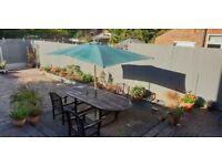 green garden parasol and base