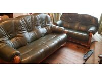 Three and Two seater green leather sofas,