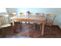 Bespoke farmhouse type pine dining table with six chairs