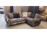 Ex-display Zebra black, white and silver fabric 4 seater corner sofa