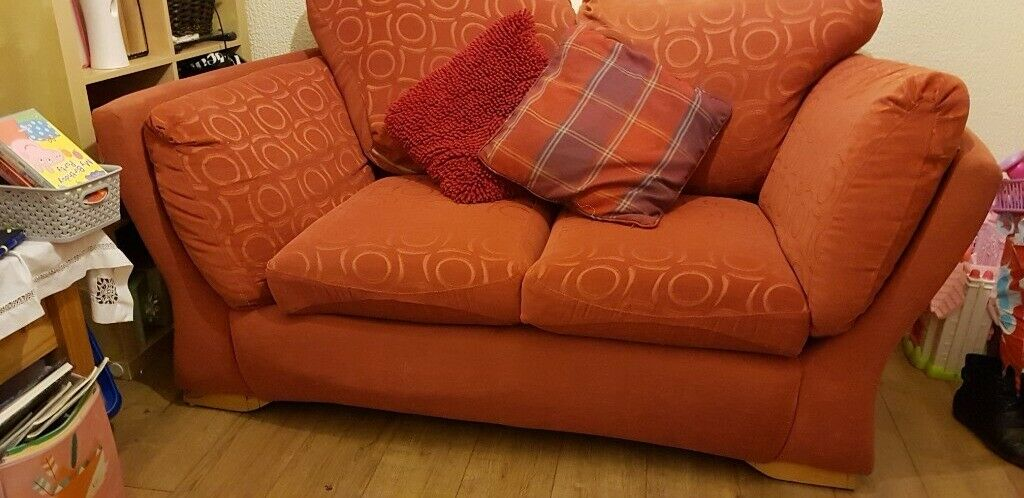 Two red cloth sofas with foot stool | in Ammanford, Carmarthenshire | Gumtree