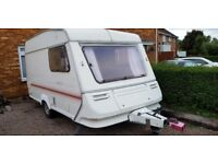 Abbey Lincoln 2 berth caravan with nearly new full awning