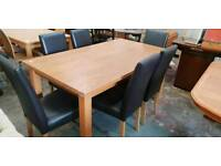 Oak dining table with 6 leather chairs