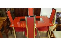 Lovely red glass dining table with machine 4 chairs excellent condition