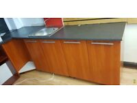 worktop with 2 double cabinets and single sink