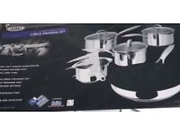 Brand new in box ideal gift RRP £198.00 set of 5 stainless steel pans i cluding frying pan