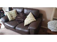 Sofa set. Set of two brown leather sofas.