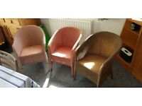 3 Lloyd Loom chairs. 2 pink, 1 gold. Good condition. Collection or local delivery