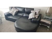 D F S black leather 3 and 2 seater Sofas with chaise