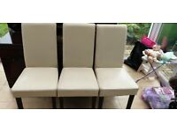 6 faux leather cream chairs