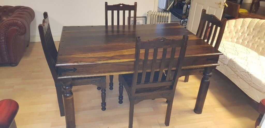 Lovely dark brown solid wood table & chairs .