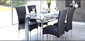 Harvey's glass dining table with 6 chairs.