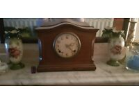 Antique over mantel clock working in good condition complete with key