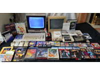 Huge Commodore 64 bundle with monitors, disk drive, tape decks, accessories, manuals, games etc.