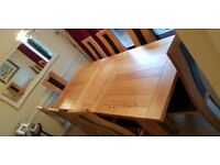 Solid oak extending dining table and 8 chairs - as new. Buyer collects £600 ono