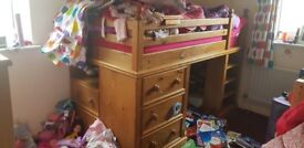 Pine midi cabin bed with draws and shelves.