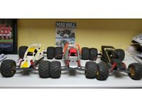 4 x Tamiya Mad Bull RC cars and loads of spares