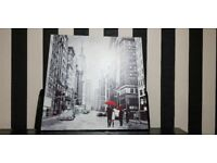 1 x BLACK AND WHITE PHOTO OF A SPANISH SIDE STREET & 1 x BLACK AND WHITE PHOTO OF A NEW YORK STREET