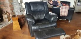 2 black recliner chairs. Well used, some splits on seams, but still plenty of life left