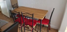 Wooden table and 4 chairs good conditiom