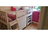 White solid wood mid sleeper bed. Pull out desk, shelves and drawer unit. Immaculate.