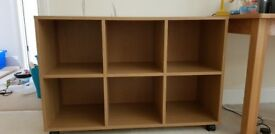 Oak finish storage unit. On castors so easily moveable. Great condition. Collection only.
