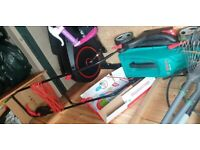 Bosh lawn mower like new used only twice