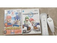 WII GAMES LIKE MARIO KART N MARIO OLYMPIC AND REMOTE WITH NUNCHUK . See description