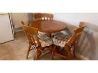 Round solid pine kitchen table & chairs.