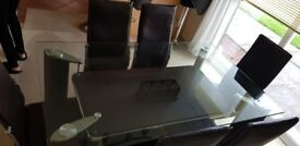 Brown dining table and 6 chairs