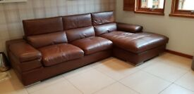 Natuzzi brown leather L shaped sofa in excellent condition. Cost £3500 new .