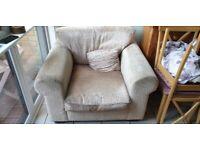 Sand colourd and textured armchair