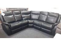 Black leather manual reclining corner sofa