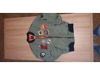 khaki and orange bomber jacket with badges