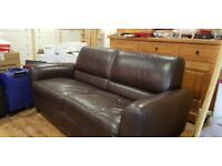 Brown leather metal framed sofa bed