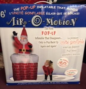 INFLATABLE SANTA WITH CHIMNEY 6 FEET